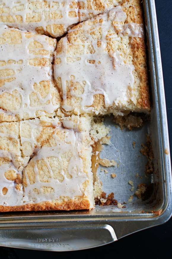 Overhead shot of apple pie cake with piece missing.