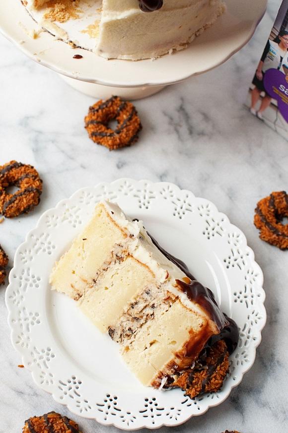 Slice of Samoa Mascarpone Layer Cake on plate