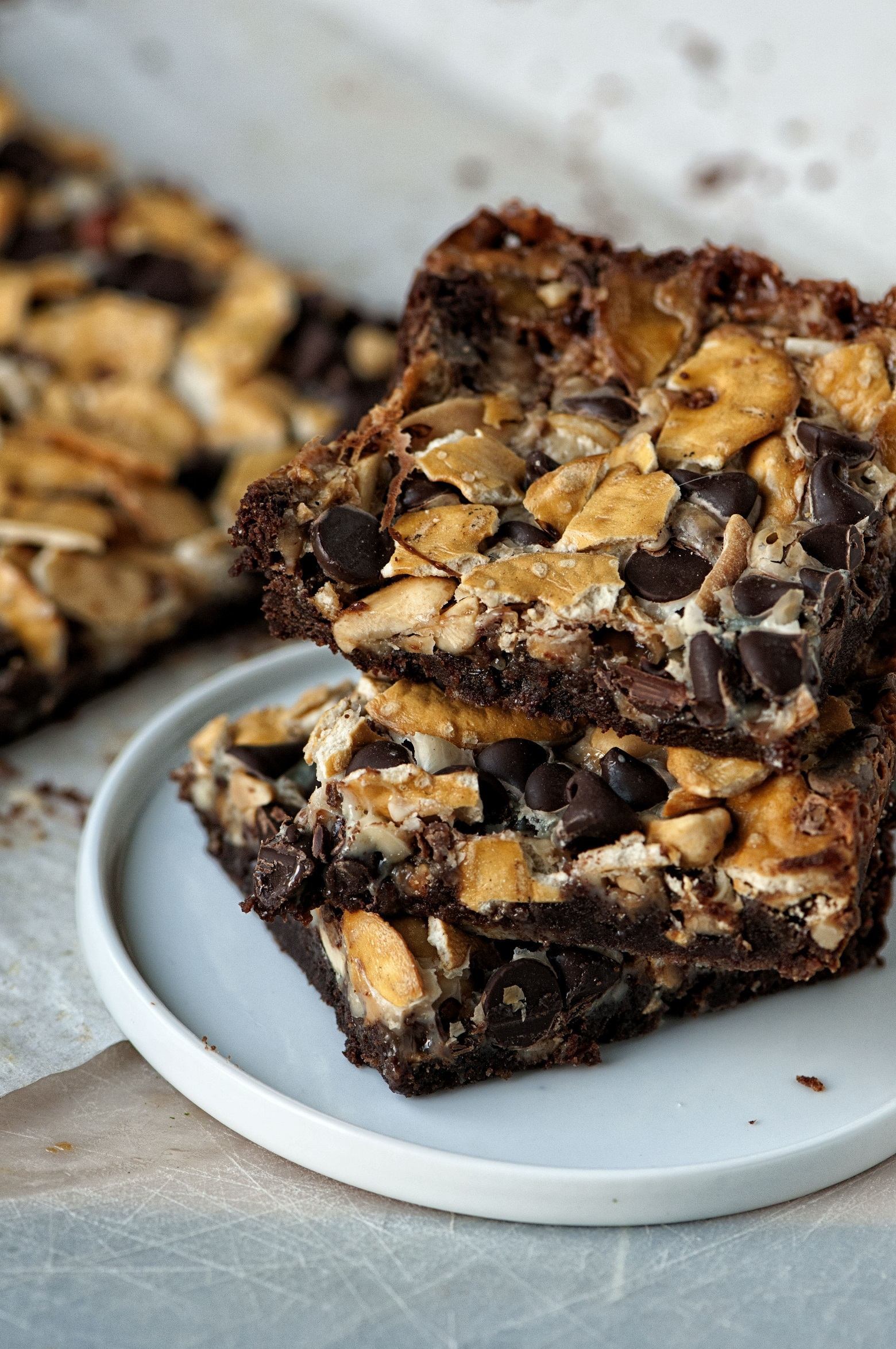 Three Cowboy 7 Layer Cookie Bars stacked up on a plate.
