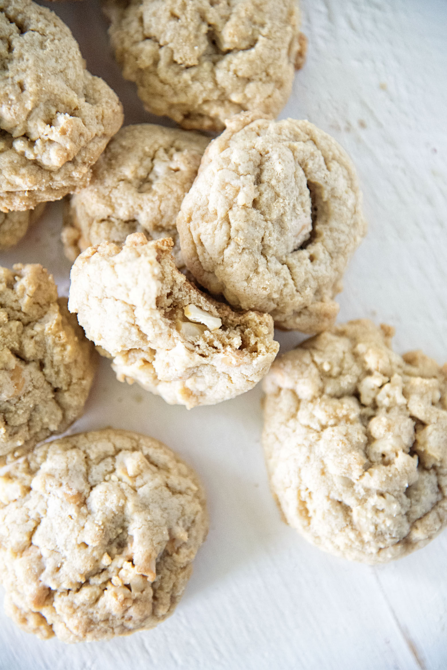 Butterscotch Salted Cashew Cookies with bite out of one.