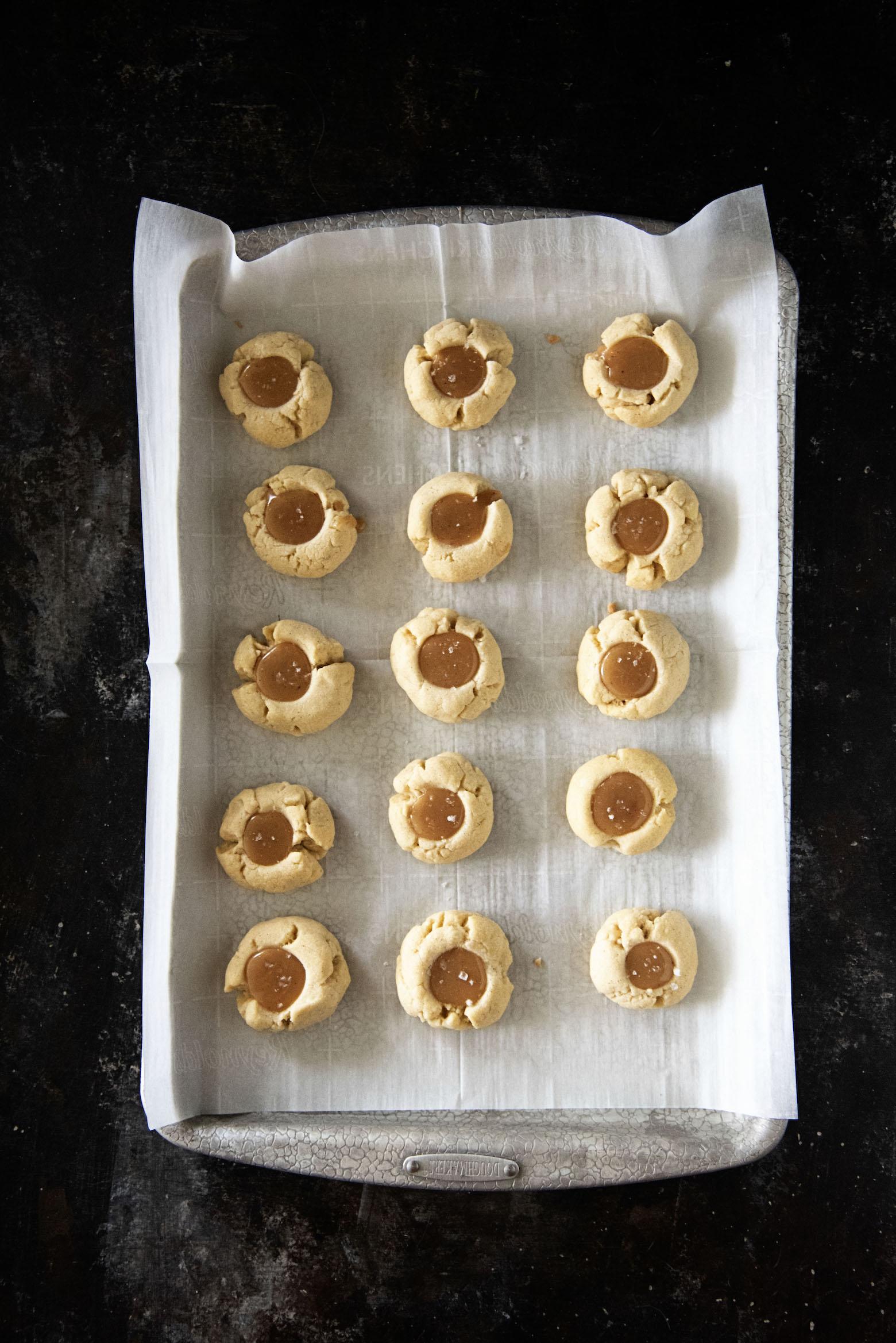 Vanilla Bean Caramel Thumbprint Cookies overhead shot on tray.