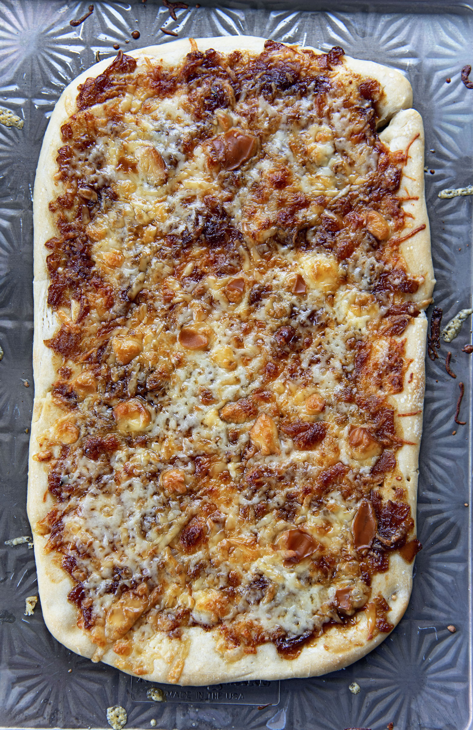 Full sheet of French Onion Soup Flatbread on baking sheet.