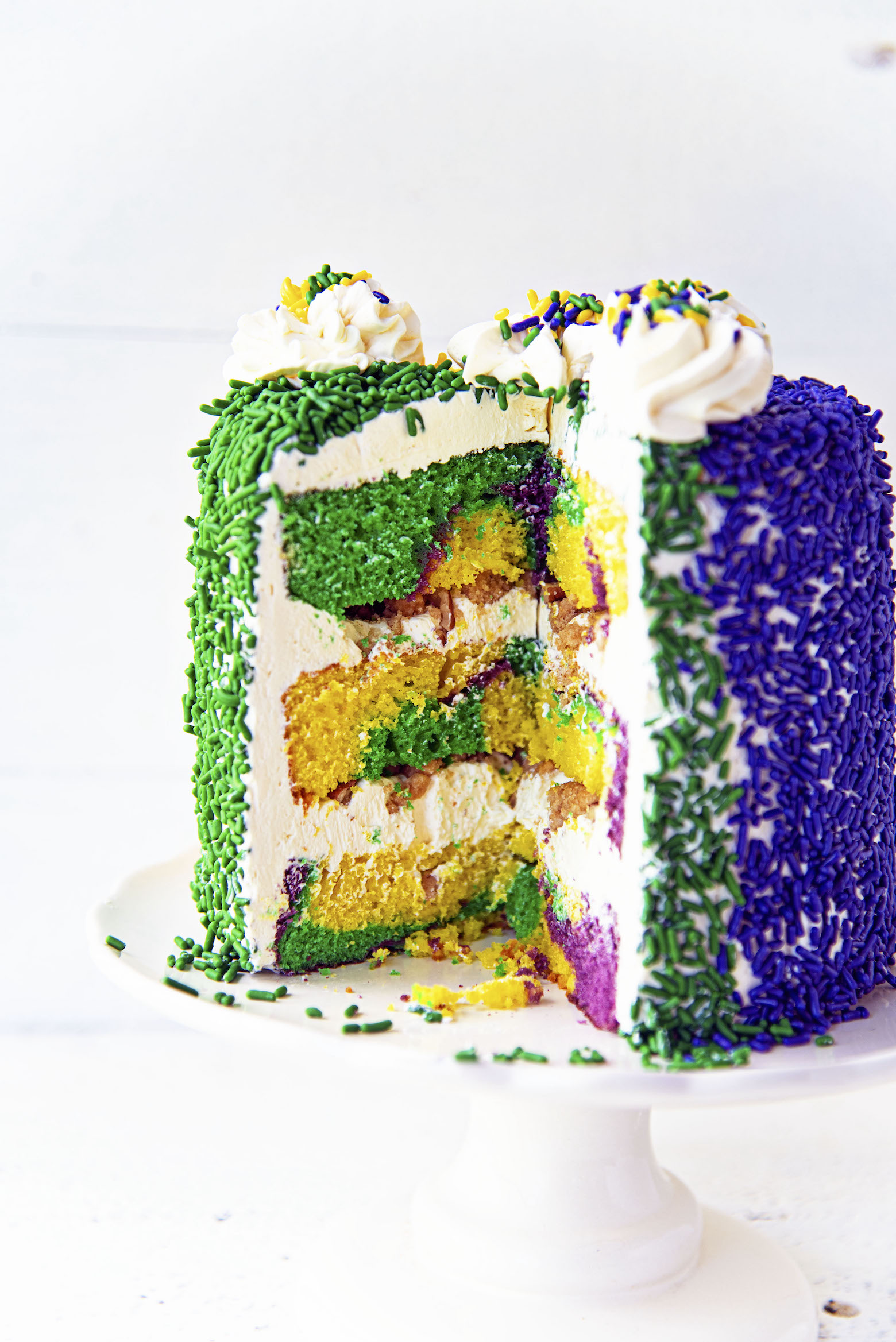 King Cake Layer Cake with cut view.