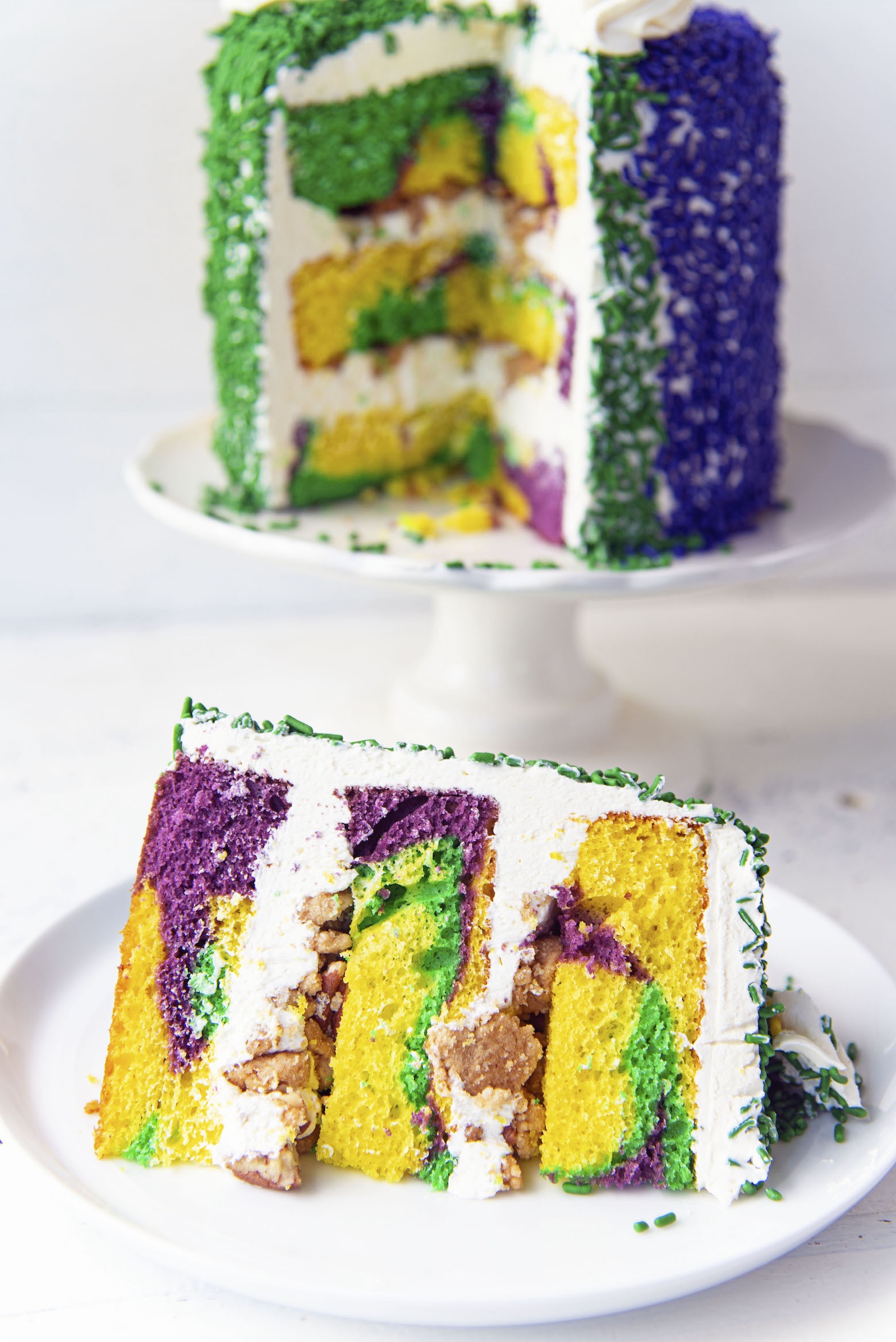 King Cake Layer Cake with slice up front and cake in back.