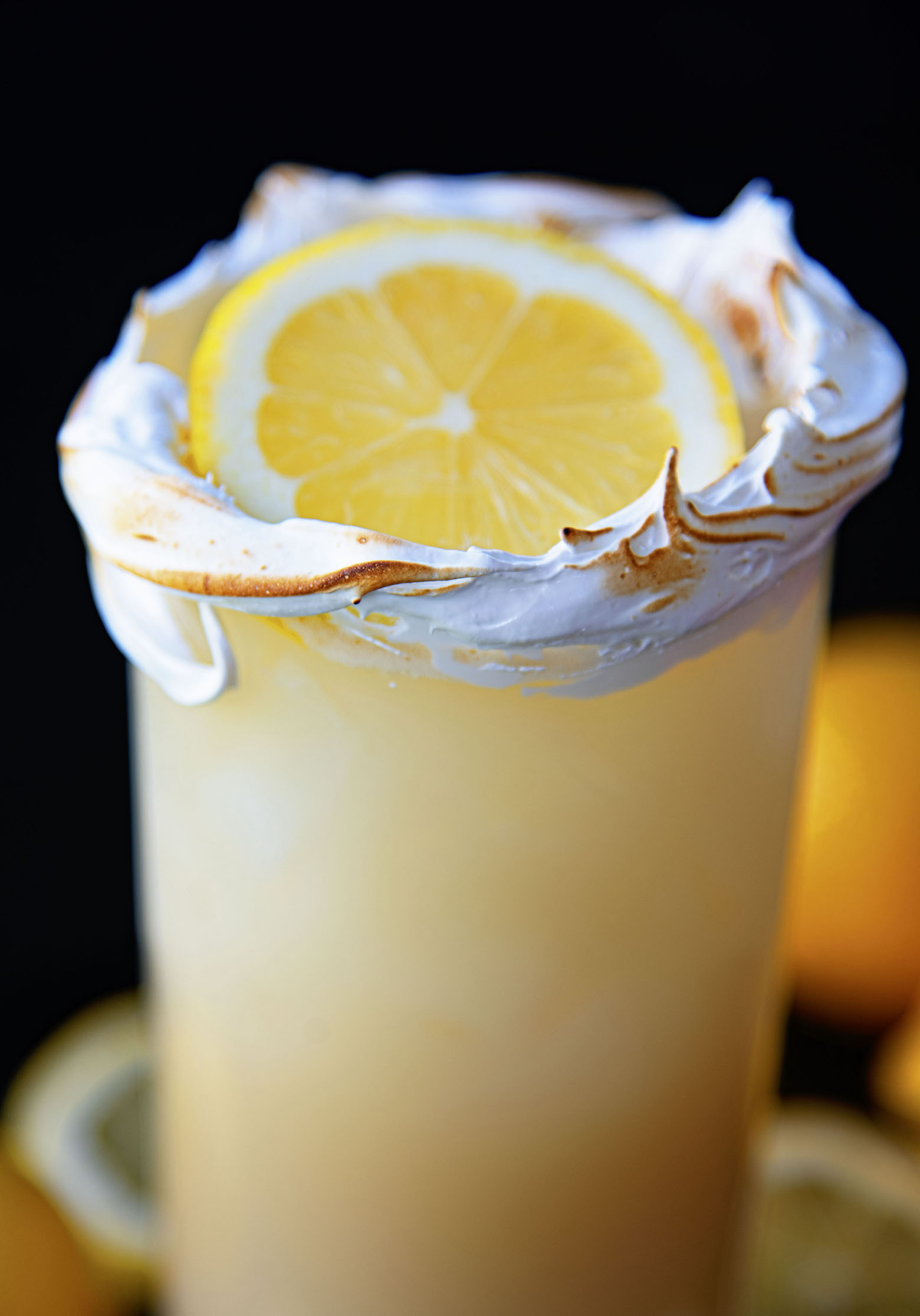 Up close shot of the cocktail and the lemon.