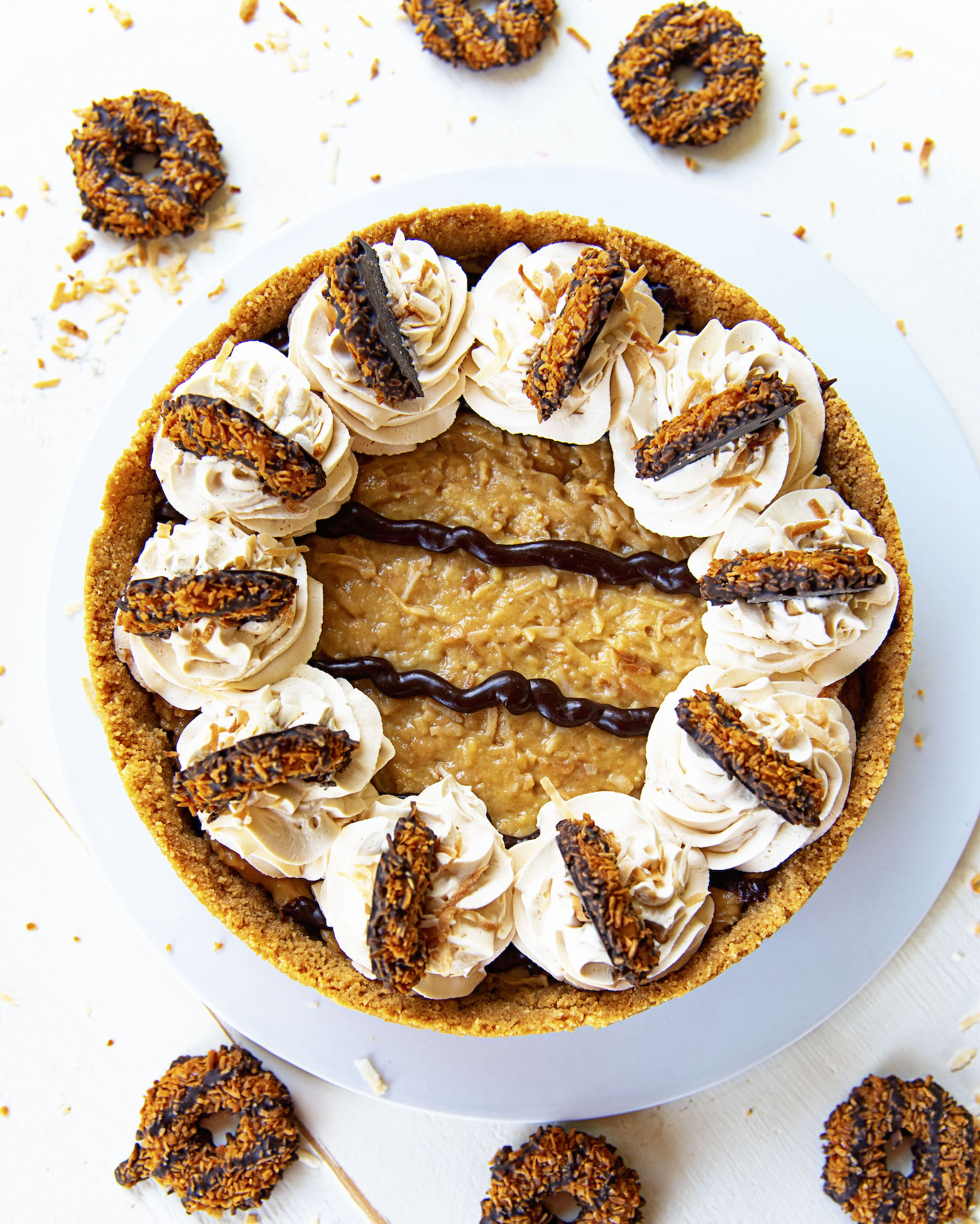 Overhead shot of Samoas Chocolate Coconut Cream Pie with scattered Samoas cookies.