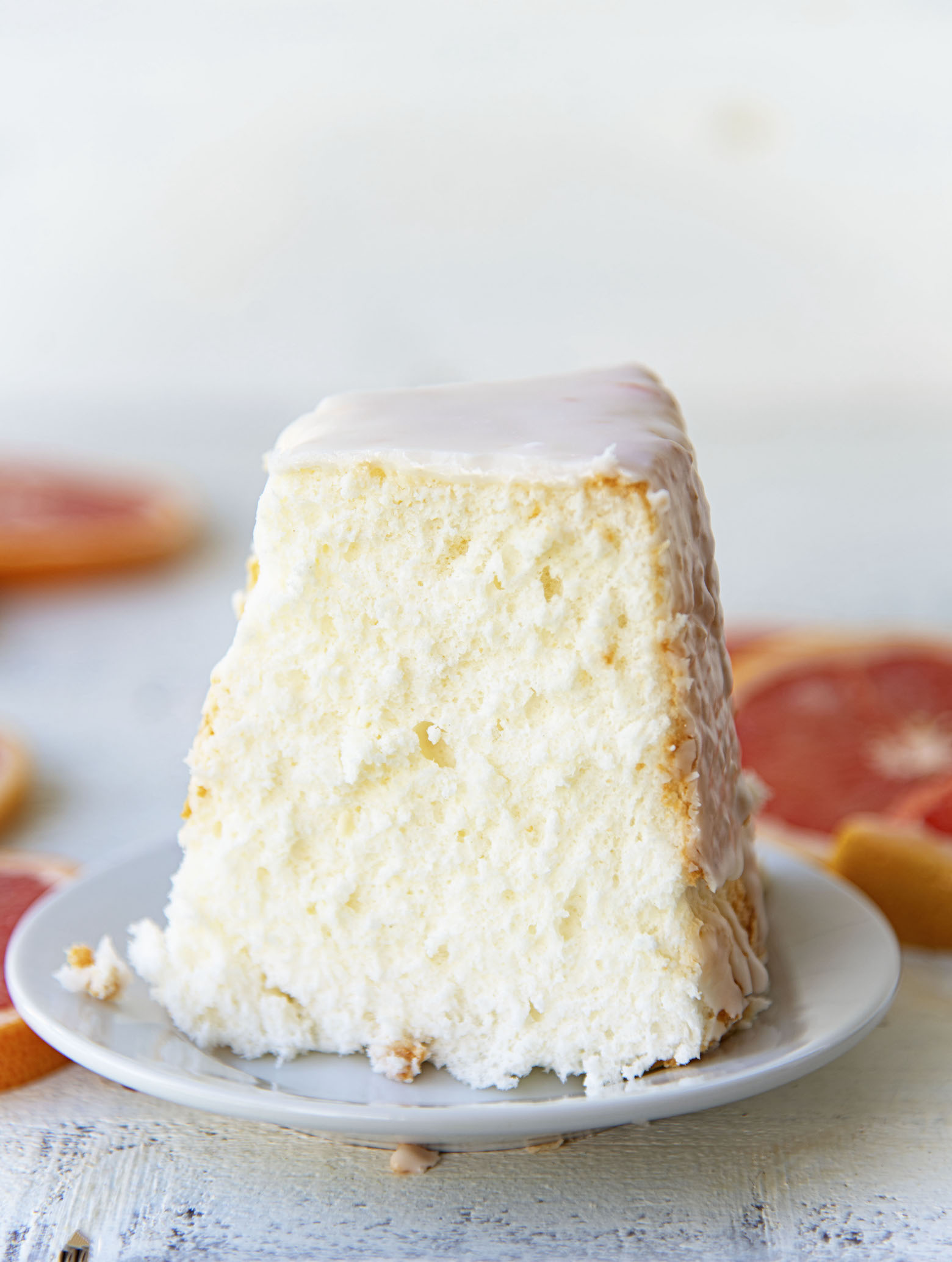 Side view of slice of Ruby Red Grapefruit Glazed Angel Food Cake