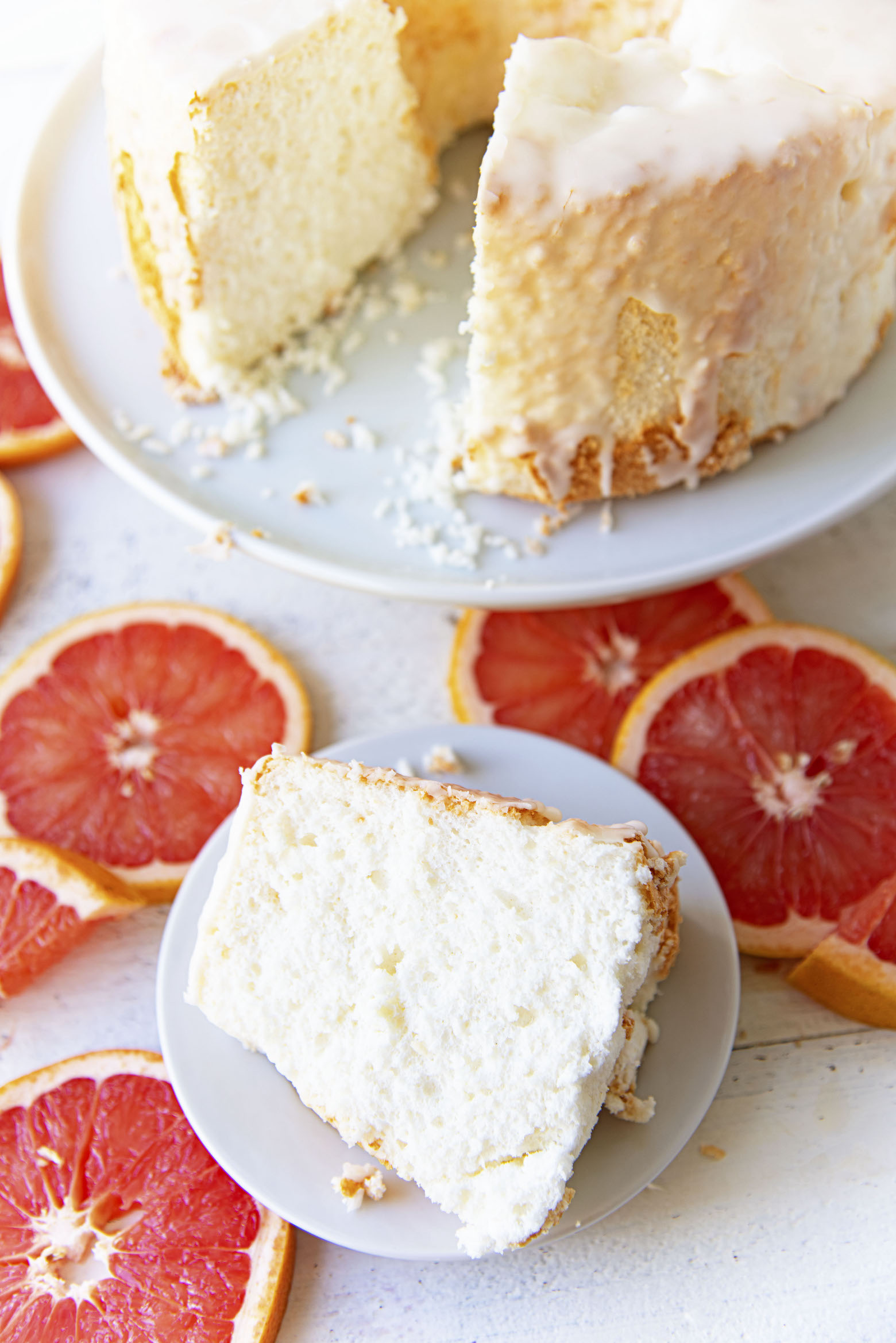 Overhead view of Ruby Red Grapefruit Glazed Angel Food Cake with slice cut out.
